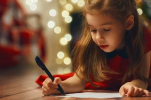 little girl writing thank you note
