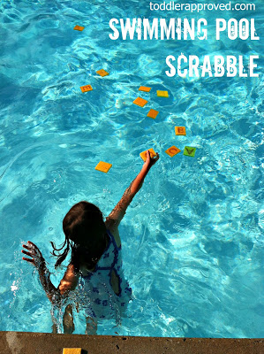 Girl swimming and collecting alphabet sponges