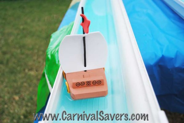 Toy boat sailing in water