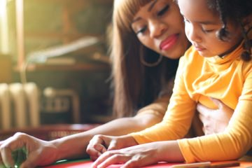 Mother and daughter engaged in a learning activity