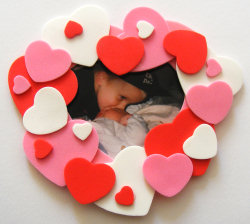 frame with hearts surrounding it