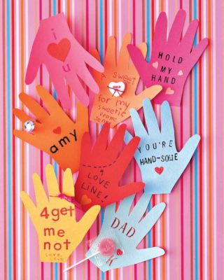 hand cutouts with written messages