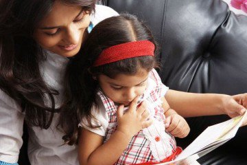 parental involvement: mother reading to child