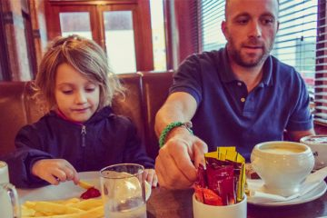 father and daughter eating together