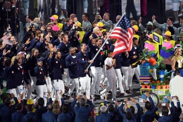 Olympic team holding US flag