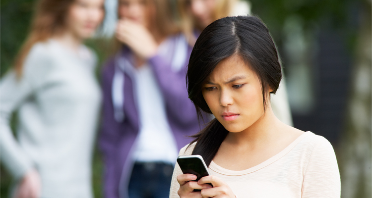 teen being bullied on her cell phone
