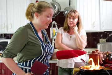 mom watching daughter fail at cooking
