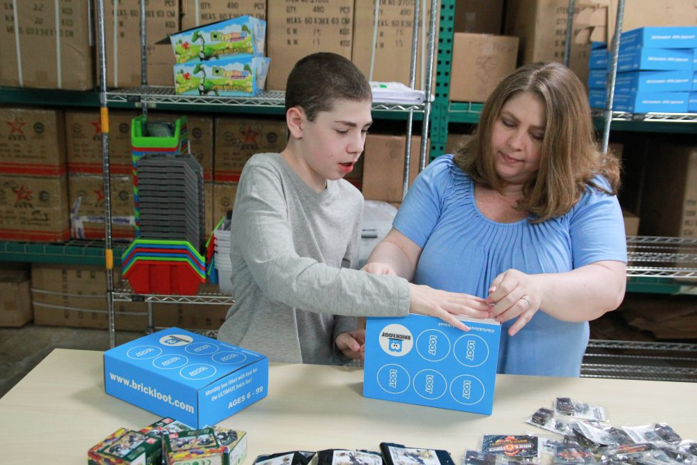 Parker and his mother Erin packing up a Brick Loot box