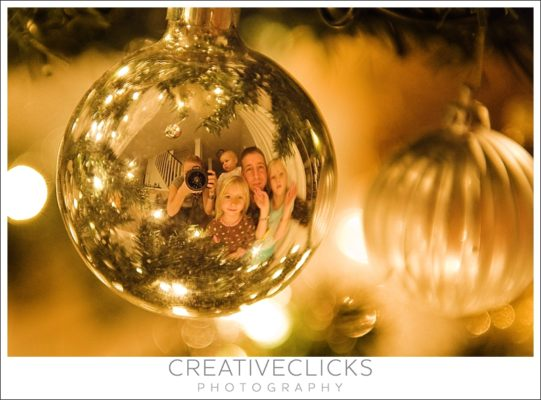 photo of a family reflected in a christmas bulb