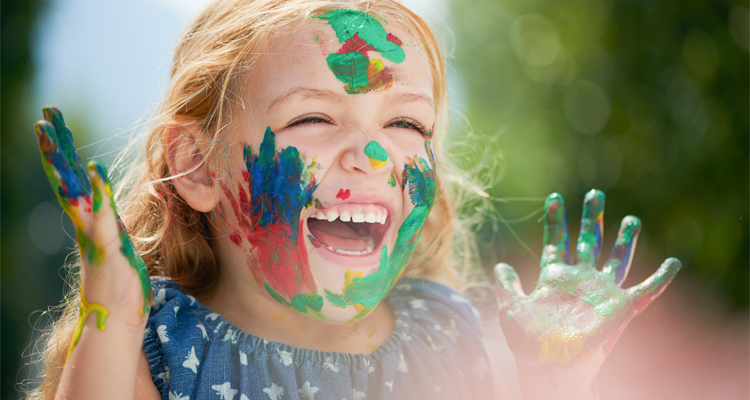 happy girl with paint on her face