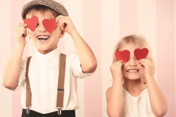 kids with paper hearts over their eyes