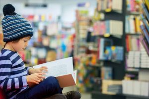 high IQ child reading in bookstore