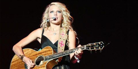 American country musician Taylor Swift performing live.