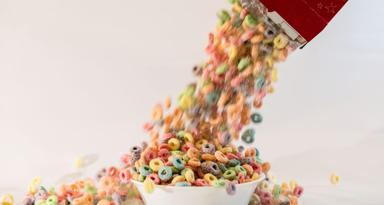 Cereal spilling into the bowl