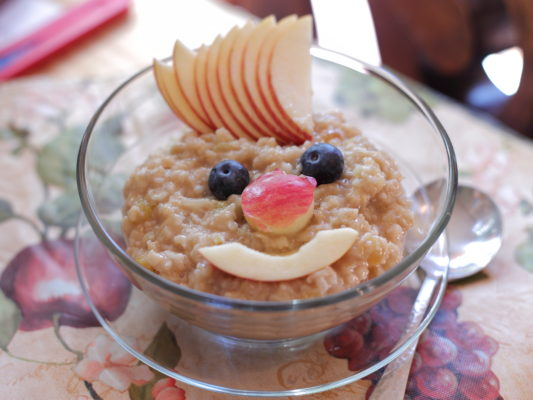 oatmeal with fruit in smiley face shape