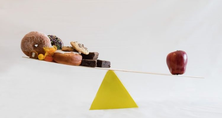 scale with food on either end