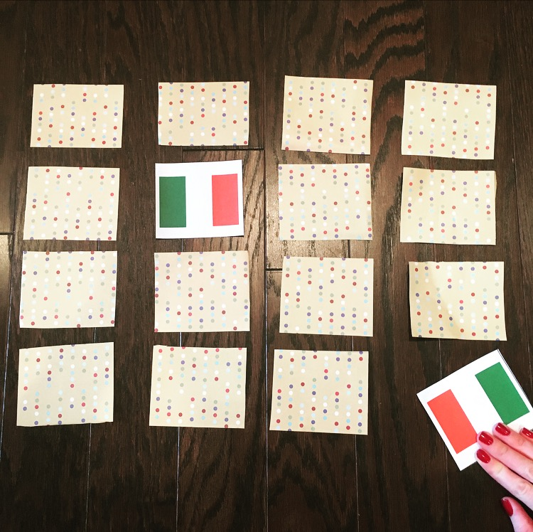 cards on a table with flag illustration on inside