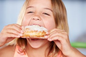 girl eating donut