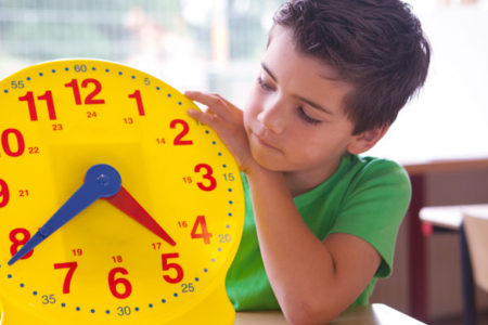 Little boy learning the clock
