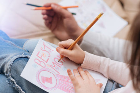 child crafting a mother's day card