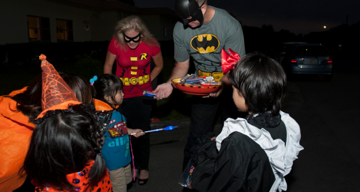 trick-or-treaters getting candy