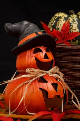 two pumpkins with witch hat