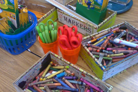 crayons and art supplies on a desk