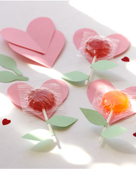 lollipops pasted to hearts with stems like flowers