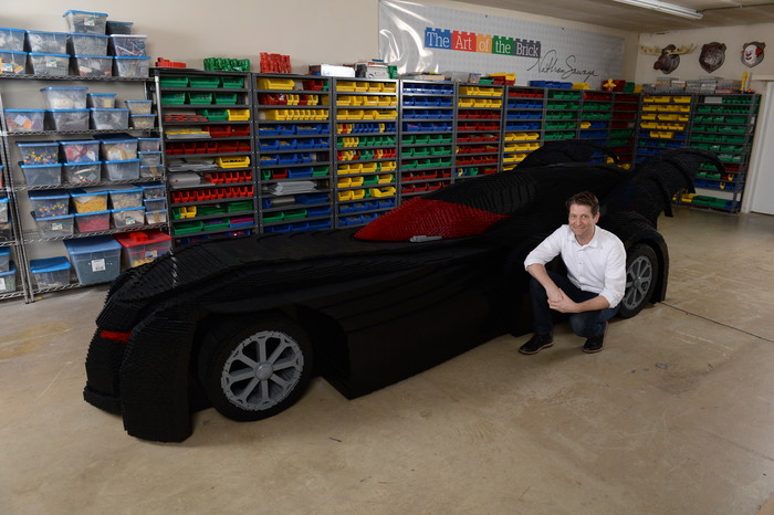 image of Nathan Sawaya with LEGO Batmobile
