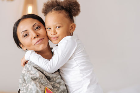 Mother in uniform with young daughter