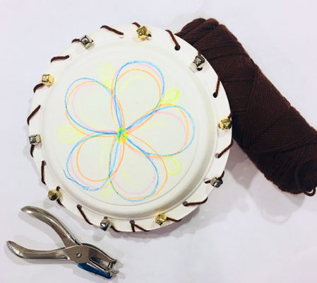 decorated paper plate with hole puncher