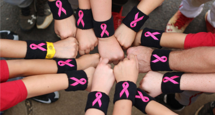 baseball players wearing breast cancer awareness wristbands