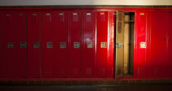 one empty locker among row of closed lockers