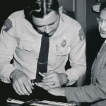 Rosa Parks being fingerprinted after bus boycott