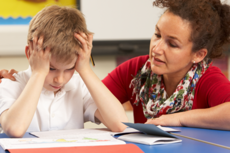 student helping stressed child