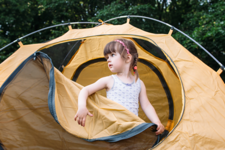 child in tent for family camping