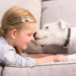child looking at dog receives many life lessons