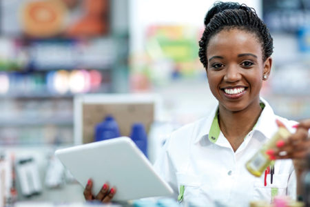 young woman pharmacist at work