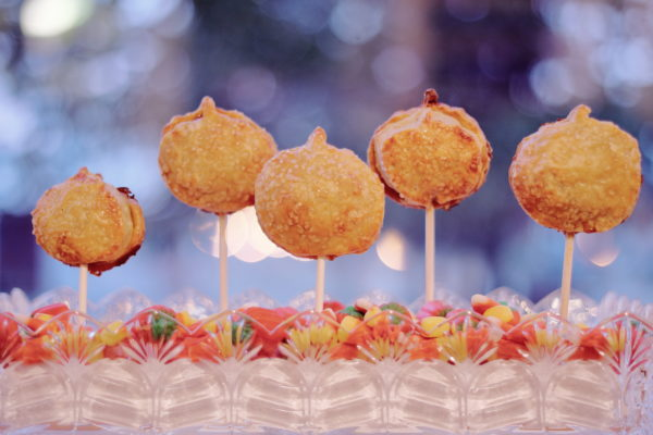 Mini pumpkin pie lollipops in a candy dish