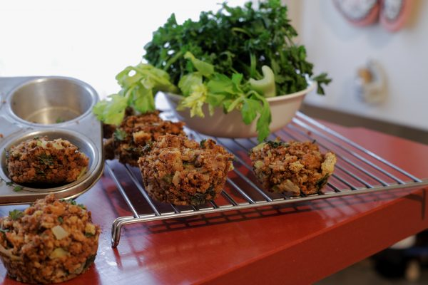 Stuffing muffins on a tray with vegetables