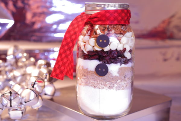 Jar of cookie ingredients with a scarf