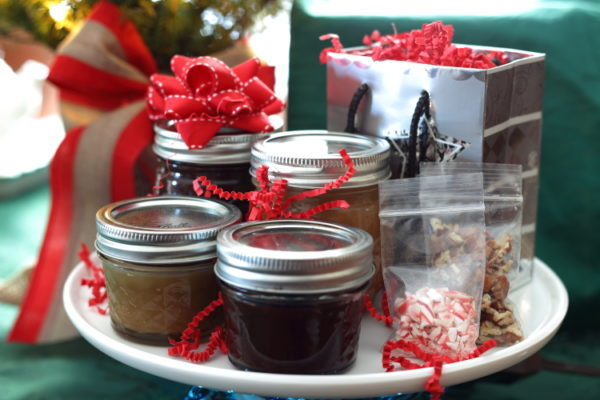 Small jars of hot fudge and toffee sauce with gift bag