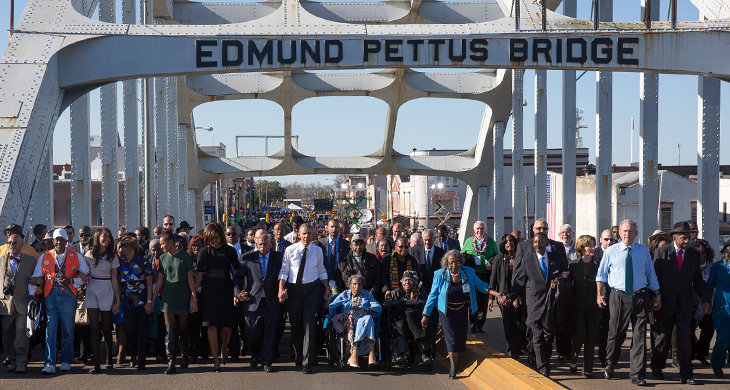 The Obamas and the Bushes continue across the bridge.