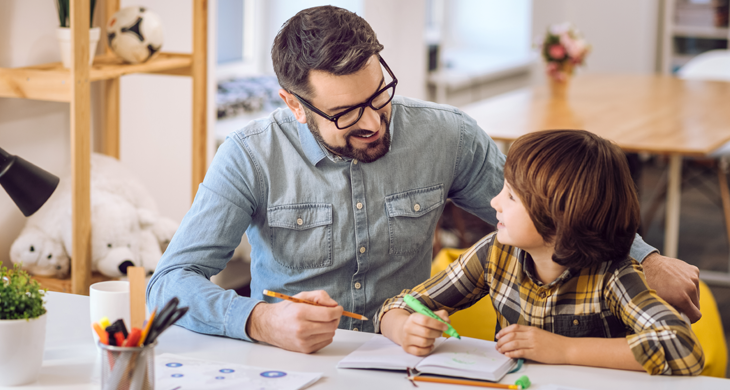 father helping child with homework