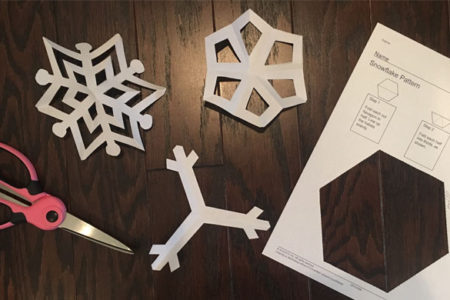 paper snowflakes with scissors