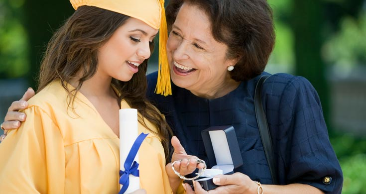 Relative giving gift to graduate