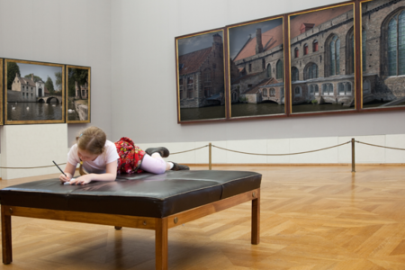 little girl drawing in an art museum