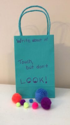 writing prompt bag with puff balls