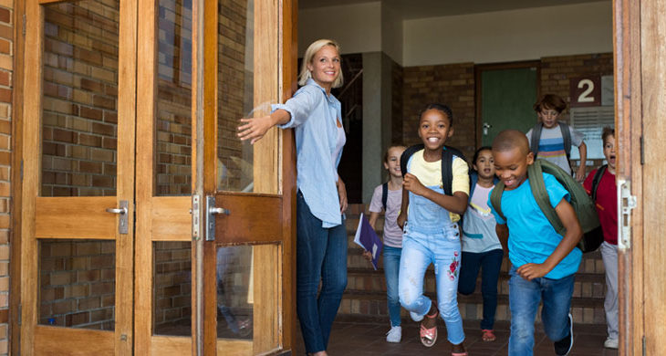 Group of elementary children leaving school for four-day school week