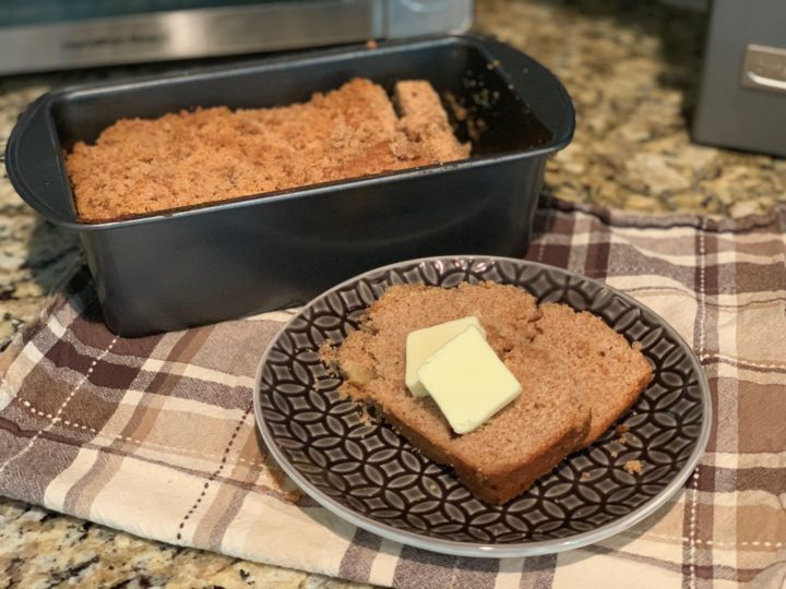 apple pie bread in a pan and on a plate with butter